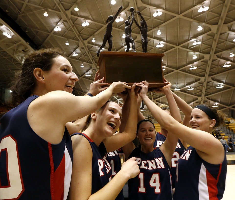 Photo - Members of the Penn women's basketball team celebrate after beating Princeton 80-64 for the Ivy League title during an NCAA college basketball game, Tuesday, March 11, 2014, in Princeton, N.J. (AP Photo/Julio Cortez)