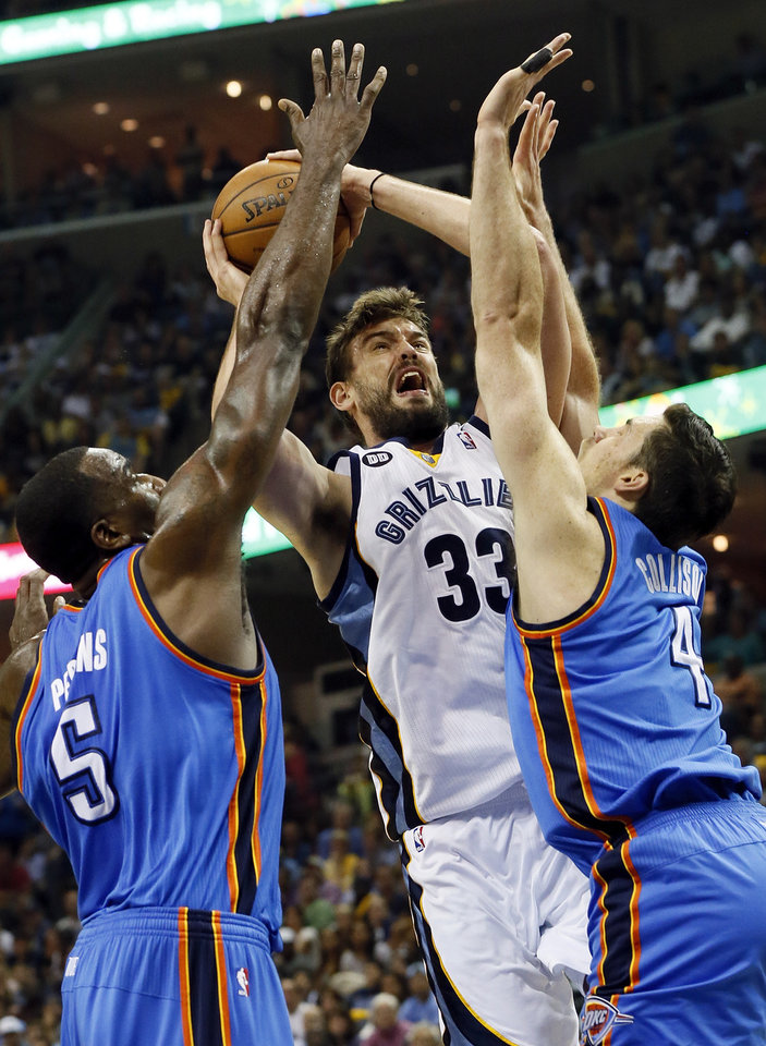 Oklahoma City's Kendrick Perkins (5) and Nick Collison (4) defend Memphis' Marc Gasol (33) during Game 3 in the second round of the NBA basketball playoffs between the Oklahoma City Thunder and Memphis Grizzles at the FedExForum in Memphis, Tenn.,  Saturday, May 11, 2013. Memphis won, 87-81. Photo by Nate Billings, The Oklahoman