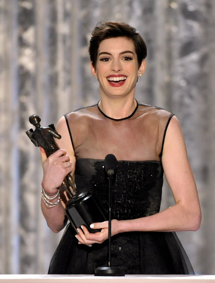 "Photo - Anne Hathaway accepts the award for outstanding female actor in a supporting role for ""Les Miserables"" at the 19th Annual Screen Actors Guild Awards at the Shrine Auditorium in Los Angeles on Sunday, Jan. 27, 2013. (Photo by John Shearer/Invision/AP)"