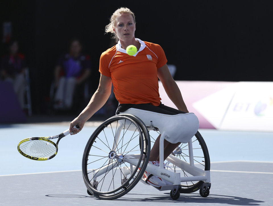 Photo -   Netherlands' Esther Vergeer returns to Netherlands' Jiske Griffioen, not seen, during the women's single wheelchair tennis semi-final match at the 2012 Paralympics, Wednesday, Sept. 5, 2012, in London. Vergeer won the match. The 31-year-old Dutchwoman has been No. 1 in the wheelchair tennis rankings for more than 13 years. The numbers Vergeer has put up since 1996, when she made her first international appearance, are staggering. She has won 42 grand slam titles (21 singles, 21 doubles) and five Paralympic golds (three singles, two doubles). From 2004-06, she won 250 straight sets. In total, she has won 162 singles titles. (AP Photo/Raissa Ioussouf)