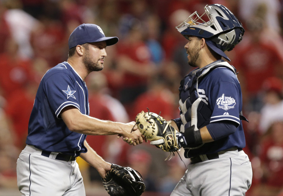 Photo - San Diego Padres relief pitcher Huston Street, left, is congratulated by catcher Rene Rivera after the Padres defeated the Cincinnati Reds 2-1 in a baseball game, Tuesday, May 13, 2014, in Cincinnati. Street earned his 12th save. (AP Photo)