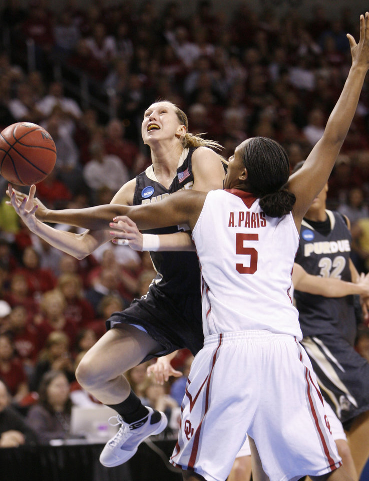 Photo - Ashley Paris blocks a shot by Natasha Bogdanova in the first half as the University of Oklahoma (OU) plays Purdue in the NCAA women's basketball regional tournament finals at the Ford Center in Oklahoma City, Okla., on Tuesday, March 31, 2009.  Photo by Steve Sisney, The Oklahoman