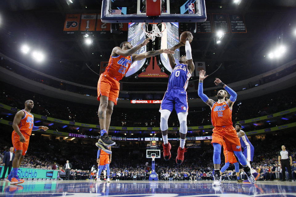 Photo - Philadelphia 76ers' Josh Richardson (0) goes up to shoot between Oklahoma City Thunder's Terrance Ferguson (23) and Steven Adams (12) during the first half of an NBA basketball game, Monday, Jan. 6, 2020, in Philadelphia. (AP Photo/Matt Slocum)