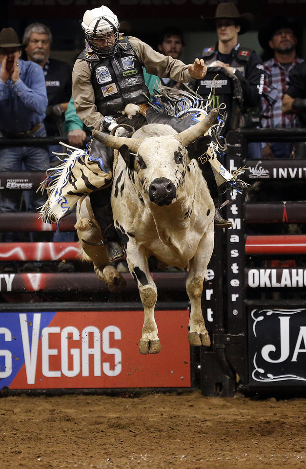 Shane Proctor rides BootDaddy.com during the WinStar World Casino Invitational PBR bull riding event at Chesapeake Energy Arena in Oklahoma City,  Sunday, Jan. 27, 2013.Photo by Sarah Phipps, The Oklahoman