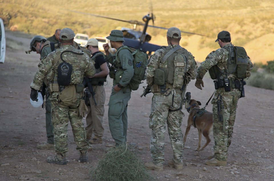 Photo -   In this photo provided by U.S. Customs and Border Protection, law enforcement officers gather at a command post in the desert near Naco, Ariz., Tuesday, Oct. 2, 2012, after a Border Patrol agent was shot to death near the U.S.-Mexico line. The agent, Nicholas Ivie, 30, and a colleague were on patrol about 100 miles from Tucson, when shooting broke out shortly before 2 a.m., the Border Patrol said. (AP Photo/U.S. Customs and Border Protection, Gabriel Guerrero)