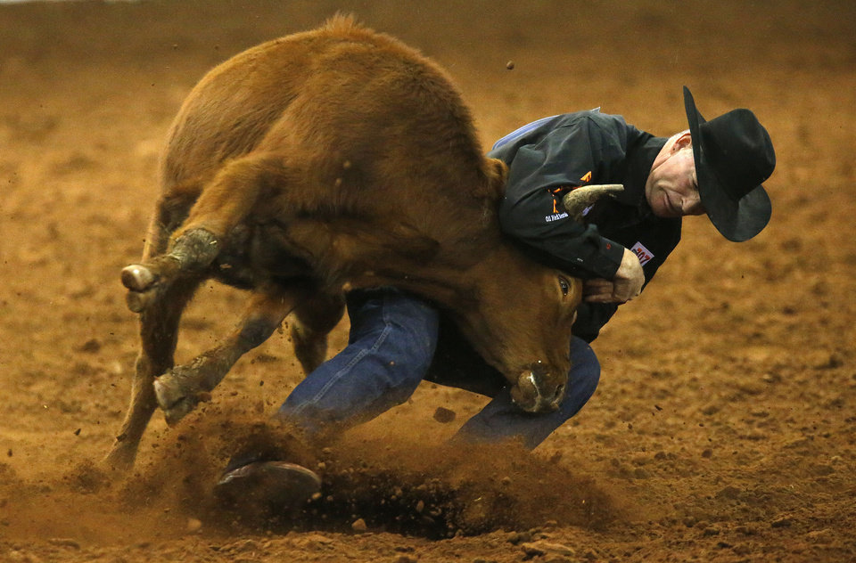 Photo - K.C. Jones participates in steer wrestling during the Timed Event Championship at the Lazy E Arena in Guthrie, Okla., Saturday,  March 3, 2013. Photo by Sarah Phipps, The Oklahoman