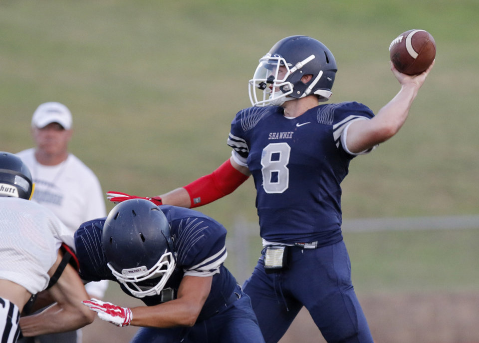 Photo - Shawnee quarterback John Jacob works the offense during a high school football scrimmage at Choctaw High School, Friday, August 22, 2014. Photo by Doug Hoke, The Oklahoman