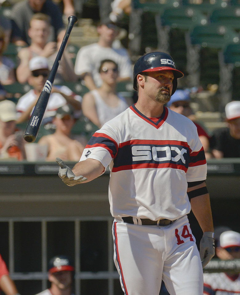 Photo - Chicago White Sox' Paul Konerko flips his bat after being called out on strikes in the sixth inning of a baseball game against the San Diego Padres on Saturday, May 31, 2014, in Chicago. (AP Photo/Matt Marton)