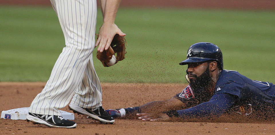 Photo - Atlanta Braves' Jason Heyward (22) slides safely to steal second base ahead of the tag from New York Mets second baseman Daniel Murphy in the first inning of a baseball game, Tuesday, July 8, 2014, in New York. (AP Photo/Julie Jacobson)