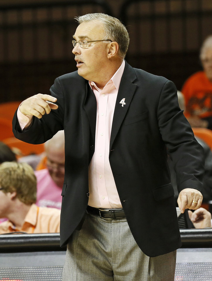 Photo - OSU head coach Jim Littell signals the Cowgirls during an NCAA women's basketball game between Oklahoma State University (OSU) and Kansas State at Gallagher-Iba Arena in Stillwater, Okla., Saturday, Feb. 16, 2013. Photo by Nate Billings, The Oklahoman