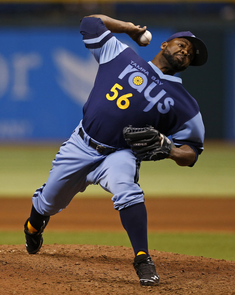 Photo - Tampa Bay Rays relief pitcher Fernando Rodney throws during the ninth inning of a baseball game against the Chicago White Sox Saturday, July 6, 2013, in St. Petersburg, Fla. The Rays won 3-0. (AP Photo/Mike Carlson)