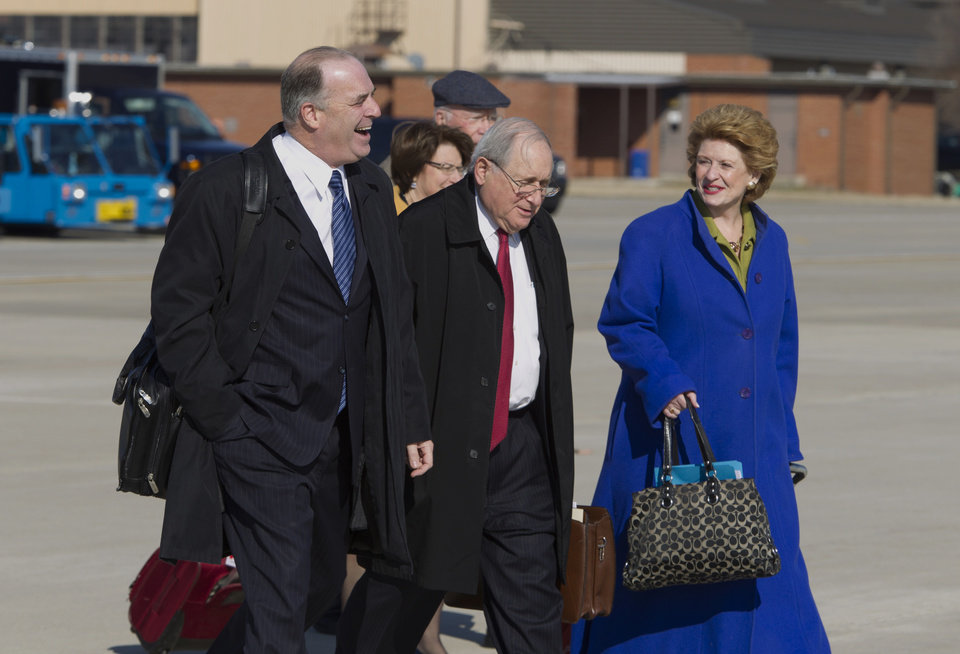 Photo - From left, Rep. Dan  Kildee D-Mich., Sen. Carl Levin  D-Mich., and Senate Agriculture Committee Chair Sen. Debbie Stabenow D-Mich., walk toward Air Force One before President Barack Obama's arrival, Friday, Feb. 7, 2014, at Andrews Air Force Base, Md. The group traveled with the president to East Lansing, Mich. where the president was to sign the farm bill at Michigan State University. ( AP Photo/Jose Luis Magana)