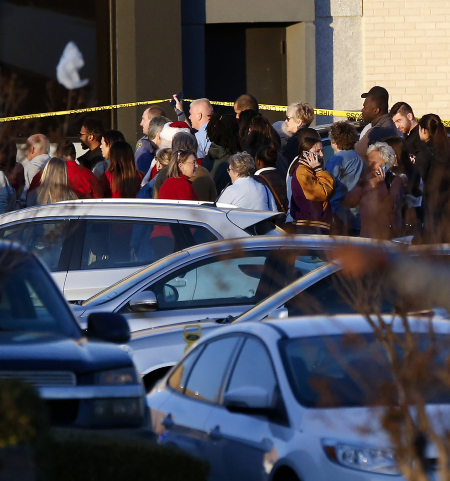 Photo - People leave the south side of Penn Square Mall after being evacuated following a shooting inside the mall in Oklahoma City, Thursday, Dec. 19, 2019. [Nate Billings/The Oklahoman]