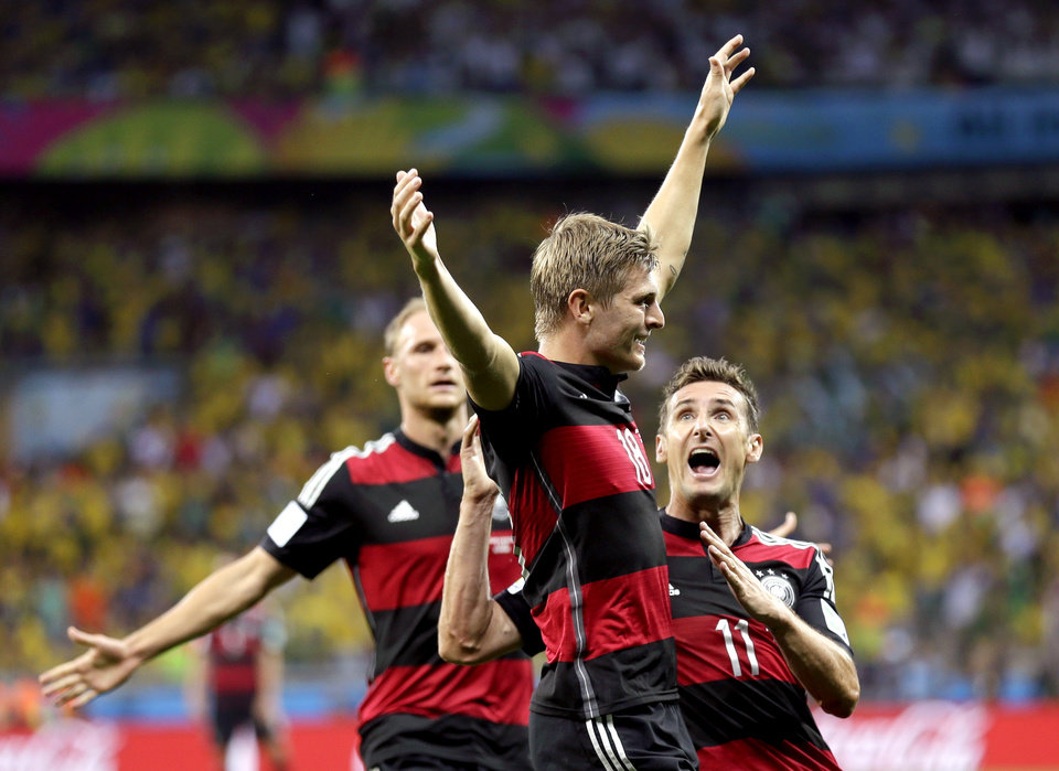 Photo - Germany's Toni Kroos celebrates with Miroslav Klose after scoring his side's third goal during the World Cup semifinal soccer match between Brazil and Germany at the Mineirao Stadium in Belo Horizonte, Brazil, Tuesday, July 8, 2014. (AP Photo/Natacha Pisarenko)
