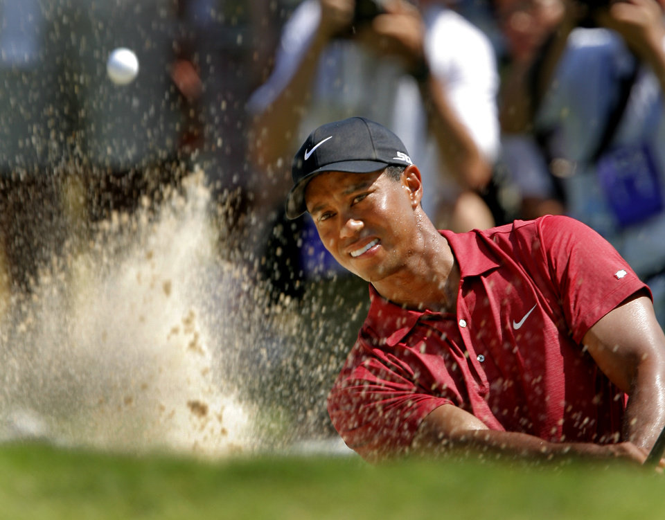 Photo - 89TH PGA CHAMPIONSHIP GOLF TOURNAMENT: TIger Woods hits his shot out of the bunker on the fifth hole during the final round of the 2007 PGA Championship at Southern Hills Country Club on Sunday, Aug. 12, 2007, in Tulsa, Okla.   By CHRIS LANDSBERGER, The Oklahoman  ORG XMIT: KOD