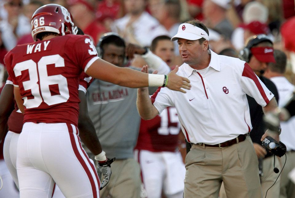 Photo - OU's Bob Stoops celebrates with Tress Way during the first half of the college football game between the University of Oklahoma Sooners (OU) and Utah State University Aggies (USU) at the Gaylord Family-Oklahoma Memorial Stadium on Saturday, Sept. 4, 2010, in Norman, Okla.   Photo by Bryan Terry, The Oklahoman