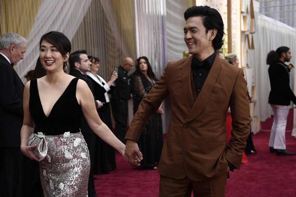 Photo - Feb 9, 2020; Los Angeles, CA, USA;   Kerri Higuchi, left, and John Cho arrive at the 92nd Academy Awards at Dolby Theatre. Mandatory Credit: Robert Hanashiro-USA TODAY