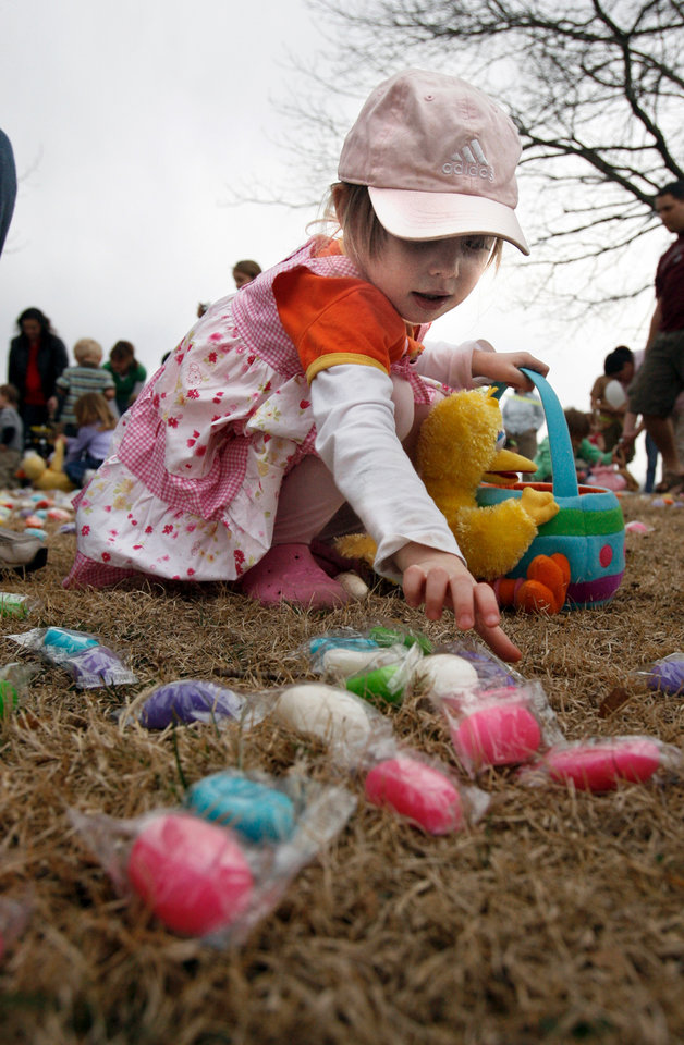 Sarah Harp, 2, gathers candy eggs at the city's annual Easter egg hunt at Andrews Park in Norman, Oklahoma on Friday, March 14, 2008.    BY STEVE SISNEY, THE OKLAHOMAN