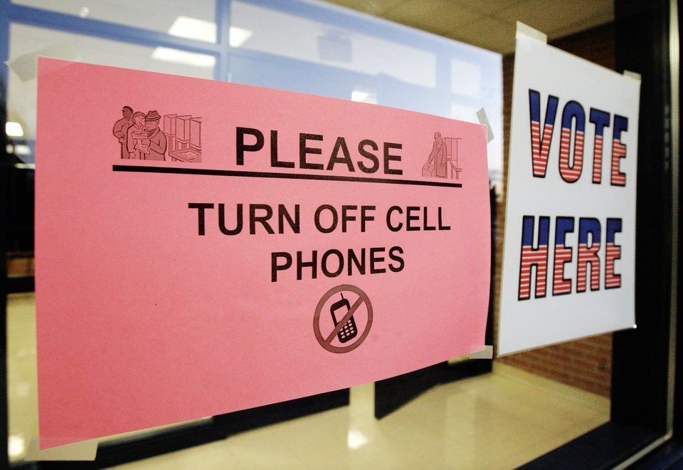 Photo - Signs posted at precinct 551 for voters at Millwood High School in Oklahoma City Tuesday, Nov. 4, 2008. BY PAUL B. SOUTHERLAND, THE OKLAHOMAN