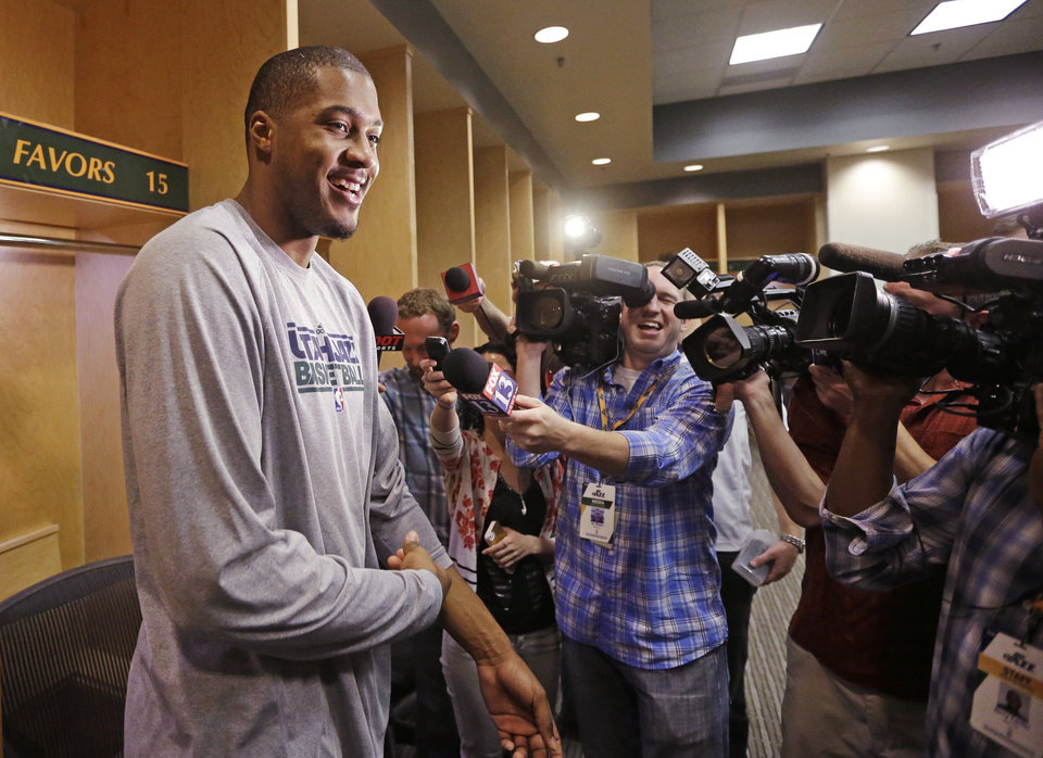 Photo - Utah Jazz's Derrick Favors speaks to reporters on the day the Jazz cleaned out their lockers after a 25-57 season, Thursday, April 17, 2014, in Salt Lake City. (AP Photo/Rick Bowmer)