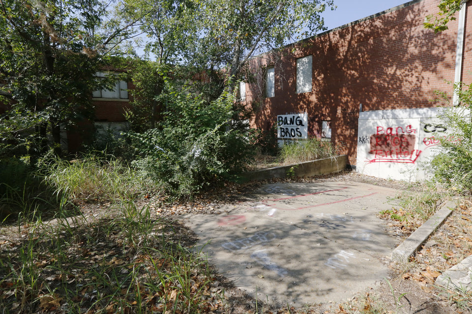 Photo -  Vandalism and neglect reflect the abandoned status of St. Vincent's Home in northeast Oklahoma City. [Photo by Paul Hellstern, The Oklahoman]