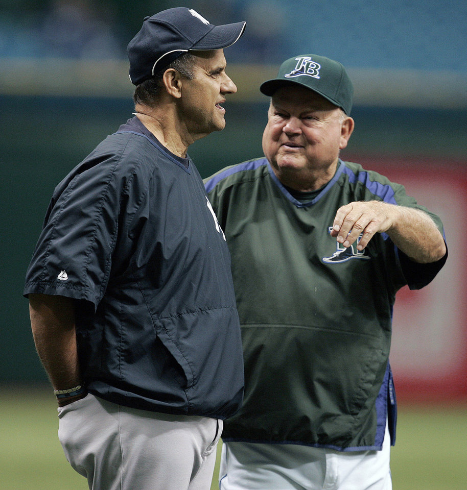 Photo - FILE - In this July 14, 2007 file photo, New York Yankees manager Joe Torre, left, talks with Tampa Bay Devil Rays special advisor Don Zimmer before the start of a baseball game S in St. Petersburg, Fla. Don Zimmer, a popular fixture in professional baseball for 66 years as a manager, player, coach and executive, has died. He was 83.  (AP Photo/Chris O'Meara, File)