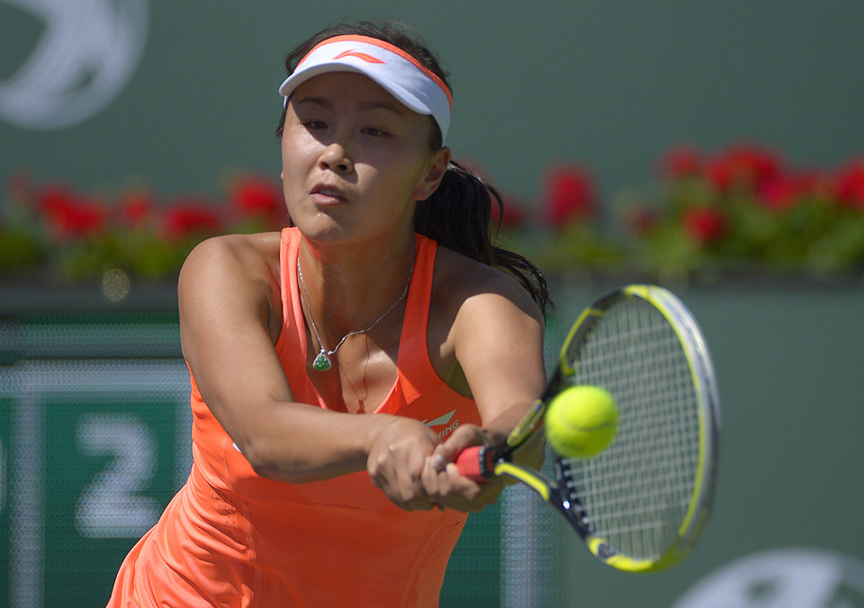 Photo - Peng Shuai, of China, returns a shot against Vera Zvonareva, of Russia, during a first round match at the BNP Paribas Open tennis tournament, Wednesday, March 5, 2014, in Indian Wells, Calif. (AP Photo/Mark J. Terrill)