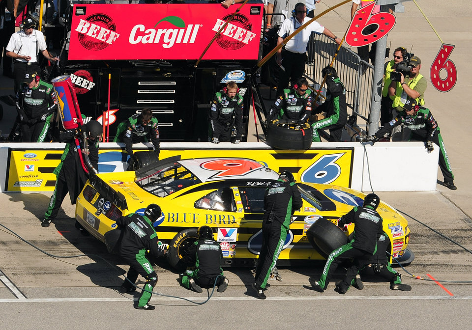 Photo -   Ricky Stenhouse Jr. (6) pits during the Dollar General 300 NASCAR Nationwide Series auto race at Chicagoland Speedway in Joliet, Ill., Saturday, Sept. 15, 2012. (AP Photo/Skip Stewart)