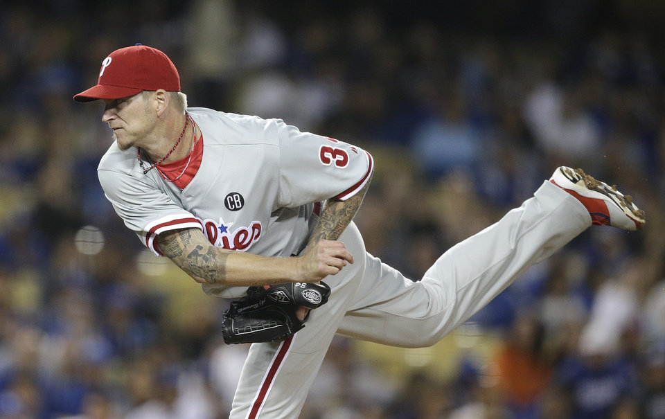 Photo - Philadelphia Phillies starting pitcher A.J. Burnett throws against the Los Angeles Dodgers during the second inning of a baseball game on Tuesday, April 22, 2014, in Los Angeles. (AP Photo/Jae C. Hong)