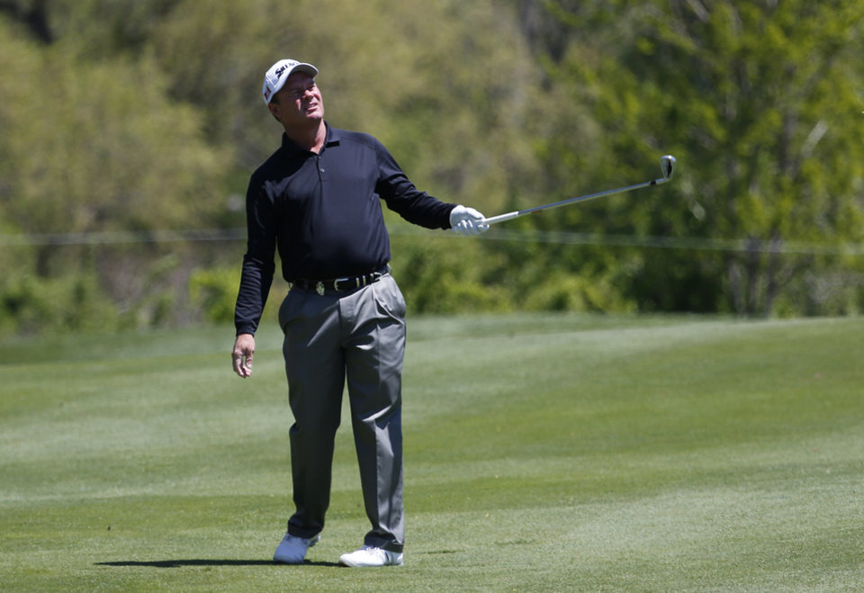 Photo - Joe Durant reacts to a fairway shot on the 16th hole during the second round of the 75th Senior PGA Championship golf tournament at Harbor Shores Golf Club in Benton Harbor, Mich., Friday, May 23, 2014. (AP Photo/Paul Sancya)