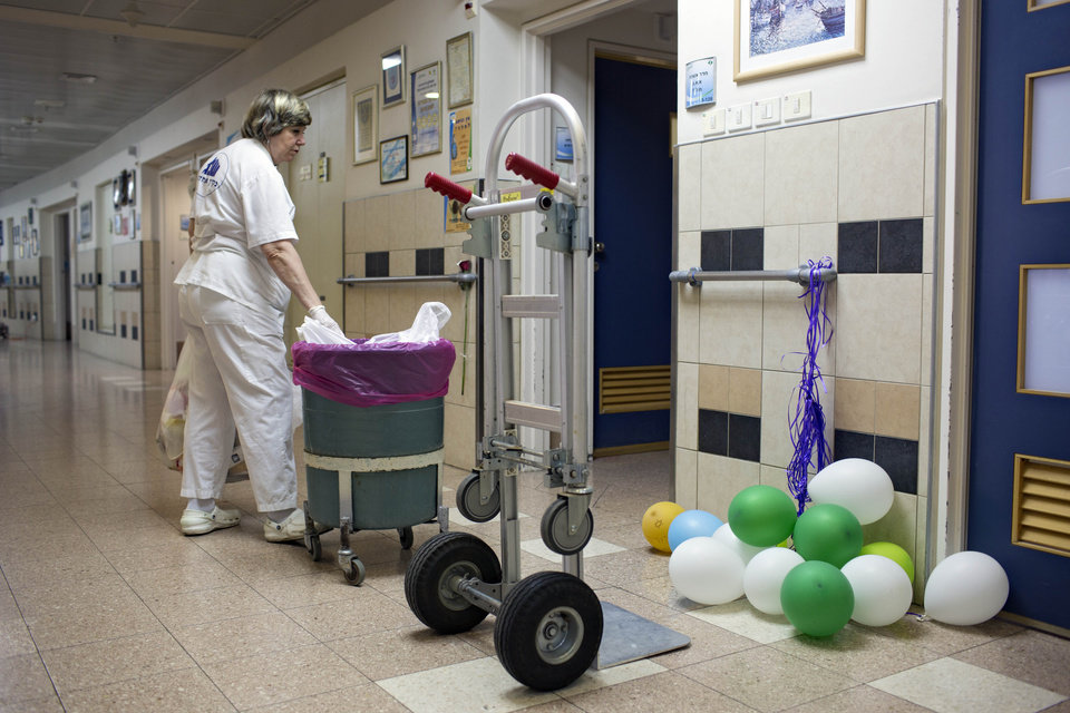 Photo - A member of the Soroka hospital staff cleans the rooms of Israeli soldiers who were wounded during fighting in Gaza, In Beer Sheva, southern Israel, Tuesday, July 29, 2014. (AP Photo/Oded Balilty)