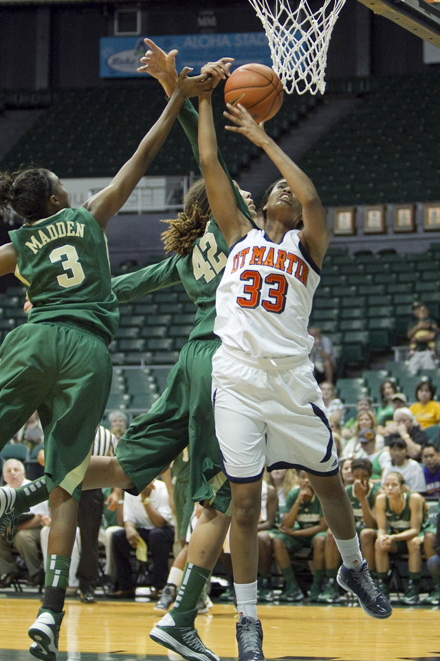 Photo -   Tennessee-Martin 's Rickiesha Bryant (33) grabs a rebound over Baylor guard Jordan Madden (3), left, and point guard Brittney Griner (42) during the first half of the NCAA college basketball game Saturday, Nov. 17, 2012 in Honolulu. (AP Photo/Marco Garcia)