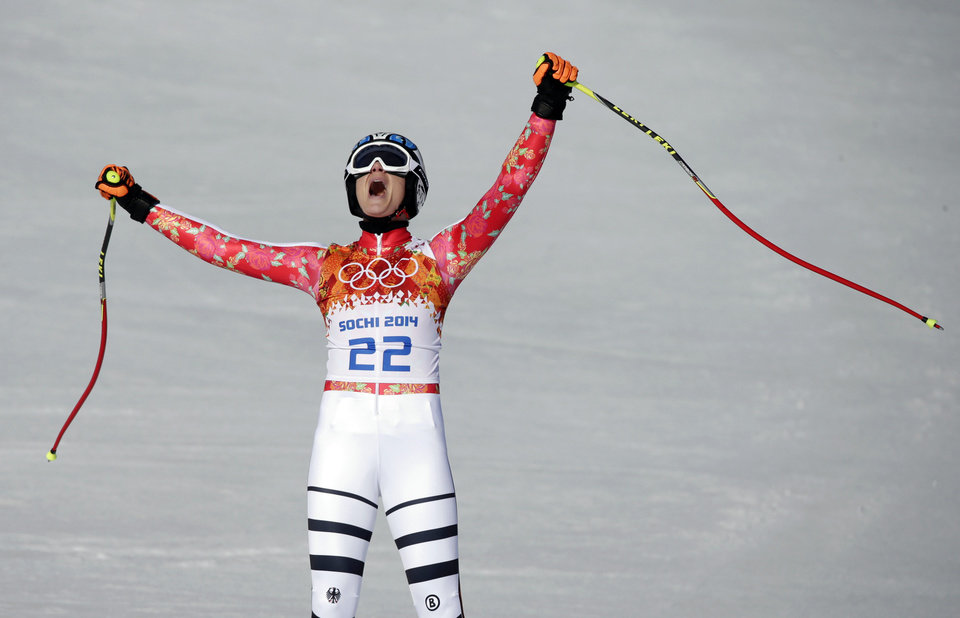 Photo - Germany's Maria Hoefl-Riesch celebrates after finishing the women's super-G at the Sochi 2014 Winter Olympics, Saturday, Feb. 15, 2014, in Krasnaya Polyana, Russia. (AP Photo/Gero Breloer, File)
