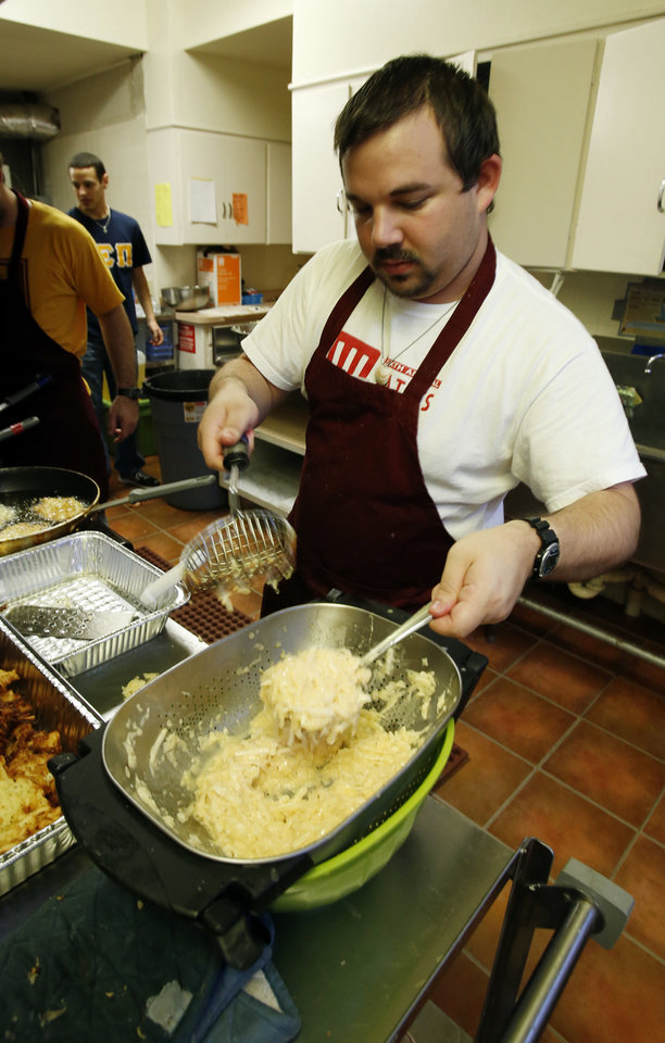 Photo - University of Oklahoma student Matthew Lorch, 22, makes latkas, the traditional potato pancakes served during Hanukkah, for the OU Hillel Foundation's annual