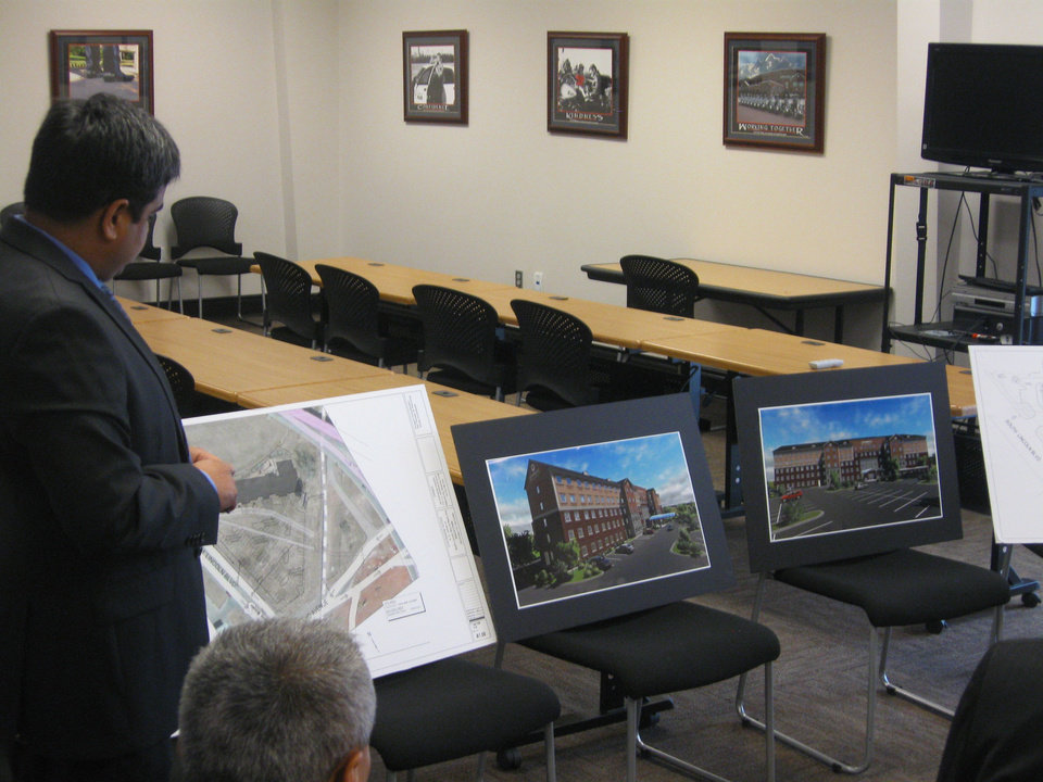 Photo - Designer Chet Patel presents renderings for the proposed Staybridge Suites in Bricktown.  Steve Lackmeyer