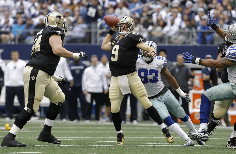 New Orleans Saints quarterback Drew Brees (9) passes the ball against the Dallas Cowboys during the first half of an NFL football game on Sunday, Dec. 23, 2012, in Arlington, Texas. (AP Photo/Brandon Wade)