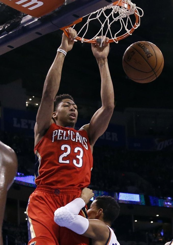 Photo - Pelican's Anthony Davis (23) dunks the ball during the NBA basketball game between the Oklahoma City Thunder and the New Orleans Pelicans at Chesapeake Energy Arena on Dec. 21, 2014 in Oklahoma City, Okla. Photo by Steve Sisney, The Oklahoman
