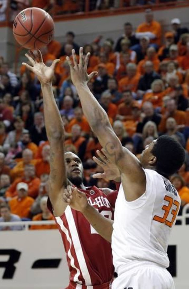 Photo -  Oklahoma's Amath M'Baye (22) shoots over Oklahoma State's Marcus Smart (33) during the Bedlam men's college basketball game between the Oklahoma State University Cowboys and the University of Oklahoma Sooners at Gallagher-Iba Arena in Stillwater, Okla., Saturday, Feb. 16, 2013. Photo by Sarah Phipps, The Oklahoman