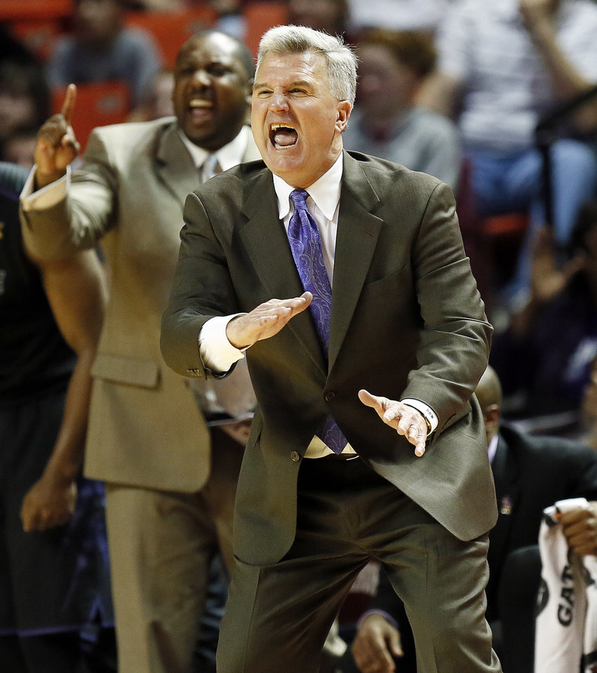 Photo - Kansas State head coach Bruce Weber gives instructions to the Wildcats during an NCAA men's basketball game between the University of Oklahoma (OU) and Kansas State at the Lloyd Noble Center in Norman, Okla., Saturday, Feb. 2, 2013. Kansas State won, 52-50. Photo by Nate Billings, The Oklahoman
