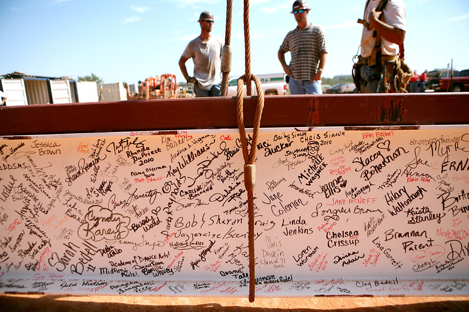 A steel beam signed by alumni, family and staff, waits to be lowered into place during a topping out ceremony at the new Yukon High School still under construction in Yukon, Okla., on Tuesday, August 31, 2010. Photo by John Clanton, The Oklahoman