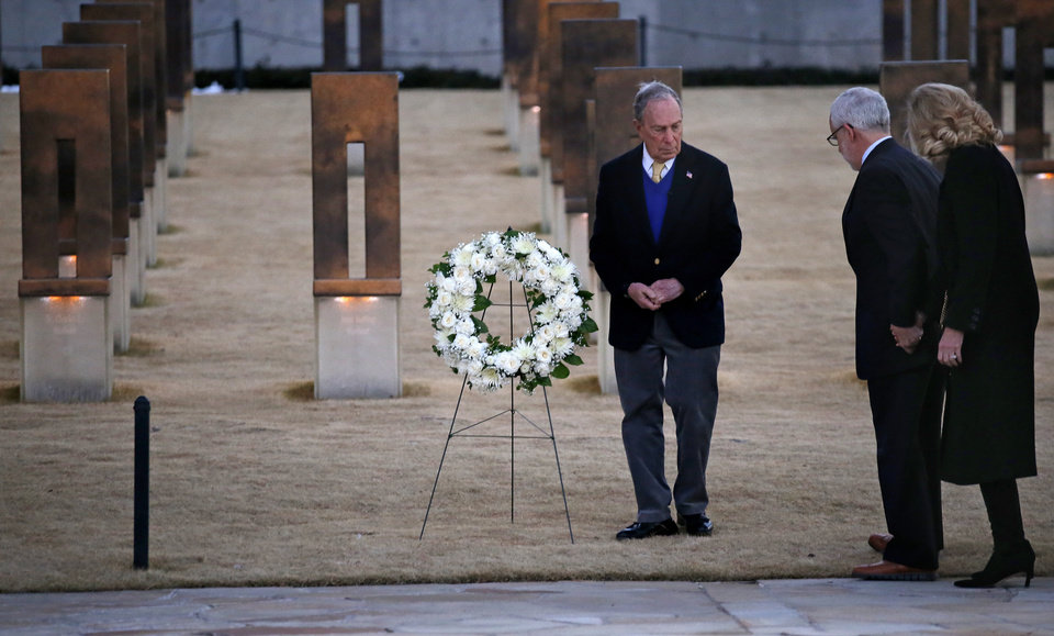 Photo - Democratic presidential candidate Mike Bloomberg places a wreath with former governor Brad Henry and his wife at the Oklahoma City National Memorial & Museum before a campaign rally in Oklahoma City, Saturday, Feb. 8, 2020.  [Sarah Phipps/The Oklahoman]