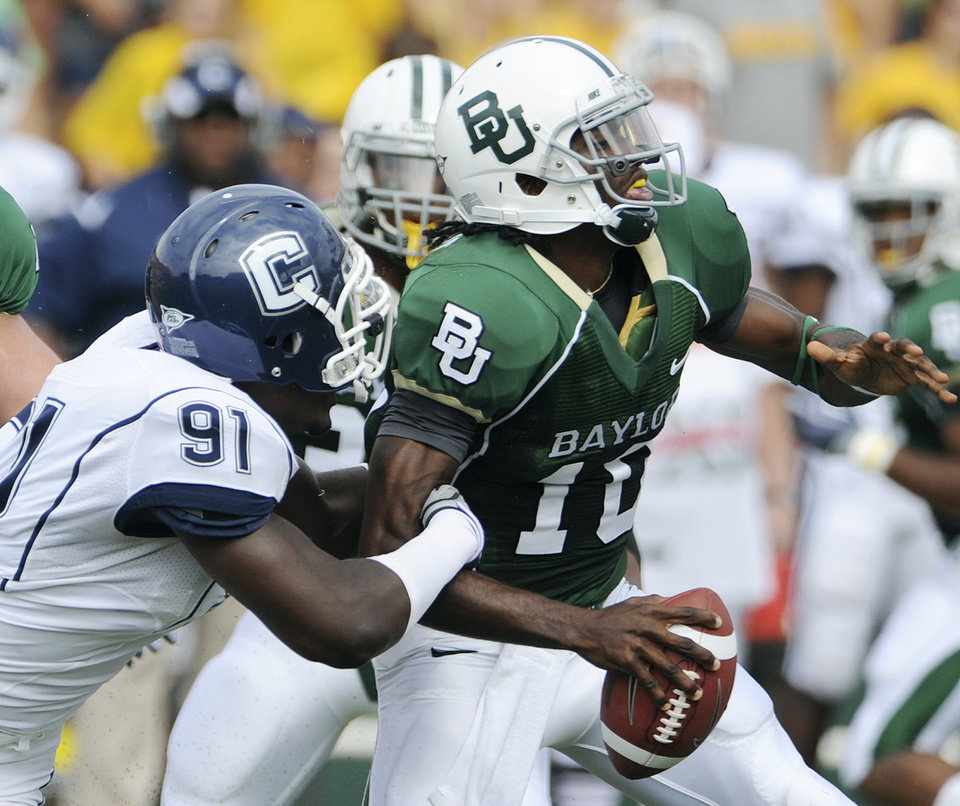 Photo - Baylor quarterback Robert Griffin wasn't among the players representing the school at Big 12 Media Days. AP PHOTO