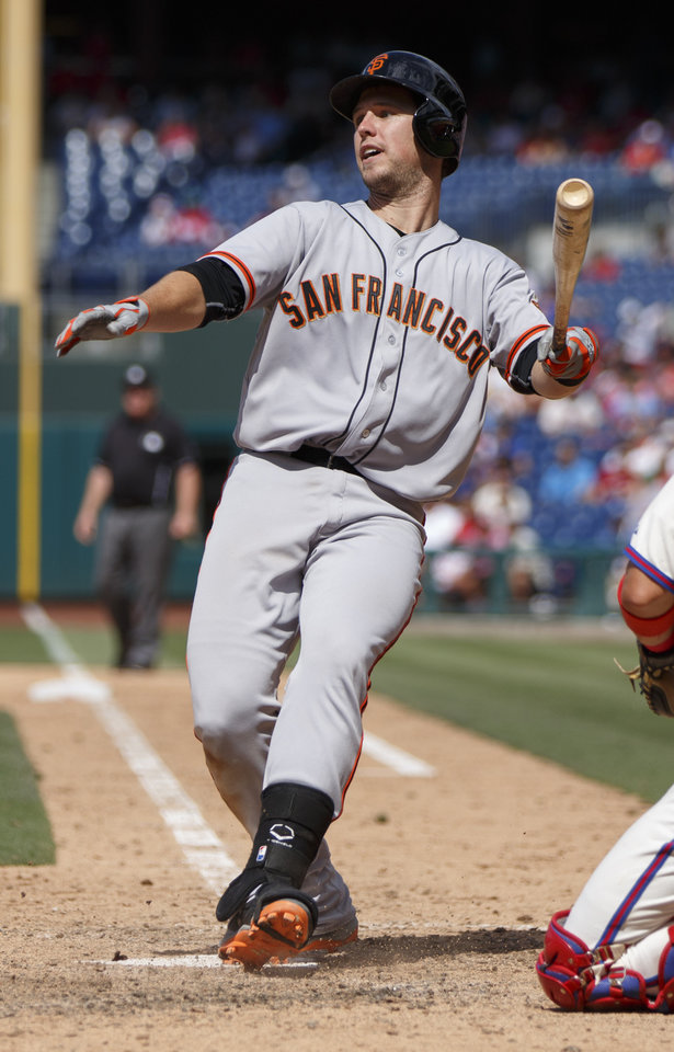 Photo - San Francisco Giants' Buster Posey loses his balance as he bats during the eighth inning of a baseball game against the Philadelphia Phillies, Thursday, July 24, 2014, in Philadelphia. (AP Photo/Chris Szagola)