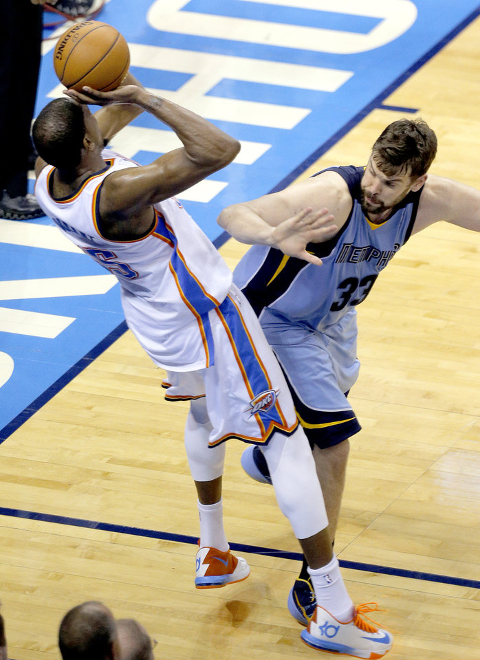 Photo - Kevin Durant (35) makes a 3-point basket as he is fouled by Memphis' Marc Gasol (33) during Game 2 in the first round of the NBA playoffs between the Oklahoma City Thunder and the Memphis Grizzlies at Chesapeake Energy Arena in Oklahoma City, Monday, April 21, 2014. Photo by Sarah Phipps, The Oklahoman