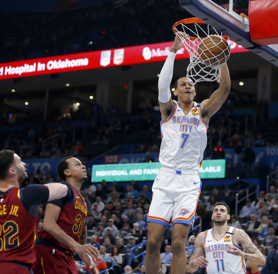 Photo - Oklahoma City's Darius Bazley (7) dunks the ball during an NBA basketball game between the Oklahoma City Thunder and the Cleveland Cavaliers at Chesapeake Energy Arena in Oklahoma City, Wednesday, Feb. 5, 2020. [Bryan Terry/The Oklahoman]