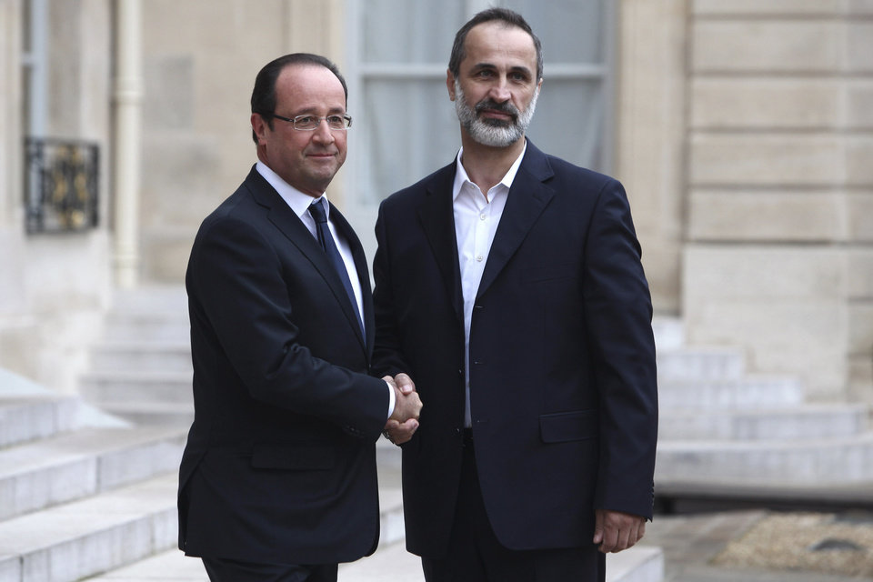 French President Francois Hollande, left, welcomes head of the new Syrian National Coalition for Opposition and Revolutionary Forces Mouaz al-Khatib, prior to a meeting, at the Elysee Palace, in Paris, Saturday, Nov. 17, 2012. France has taken a leading role among Western countries in supporting Syria\'s rebels. On Tuesday, it became the first Western nation to formally recognize Syria\'s newly formed opposition coalition as the sole legitimate representative of the Syrian people. (AP Photo/Thibault Camus)