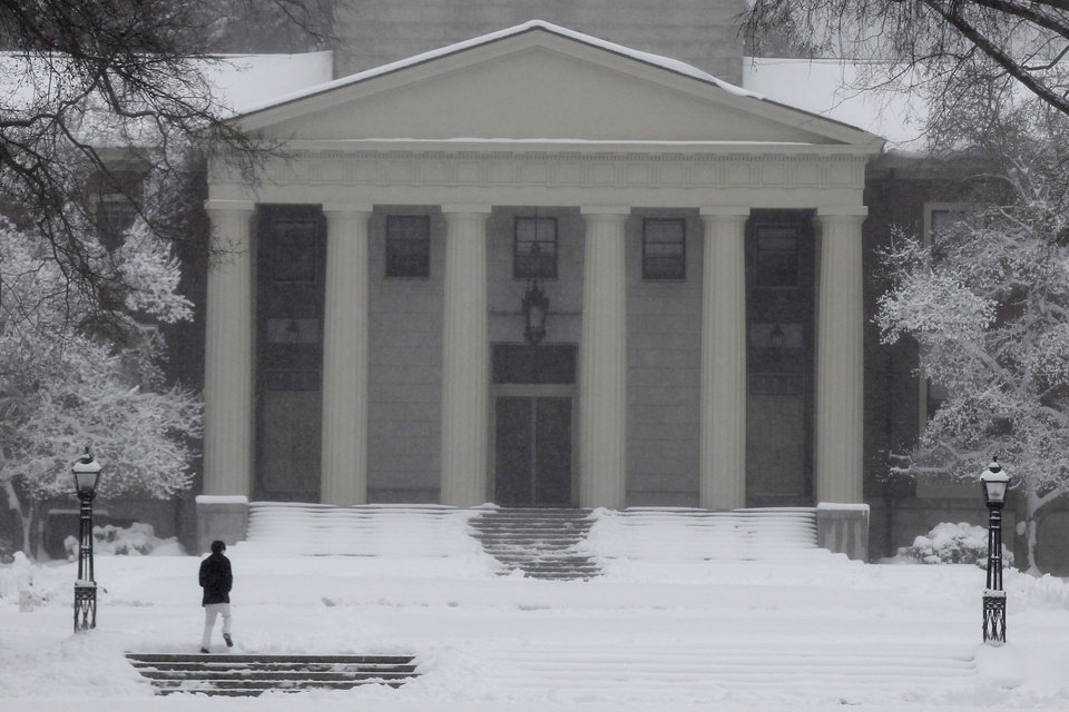 A woman walks through a snowstorm on the campus of Phillips Academy in Andover, Mass. Tuesday, March 19, 2013. (AP Photo/Winslow Townson)