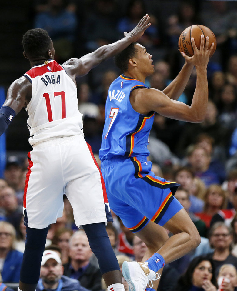 Photo - Oklahoma City's Darius Bazley (7) shoots in front of Washington's Isaac Bonga (17) in the third quarter during an NBA basketball game between the Oklahoma City Thunder and the Washington Wizards at Chesapeake Energy Arena in Oklahoma City, Friday, Oct. 25, 2019. The Wizards won 97-85. [Nate Billings/The Oklahoman]