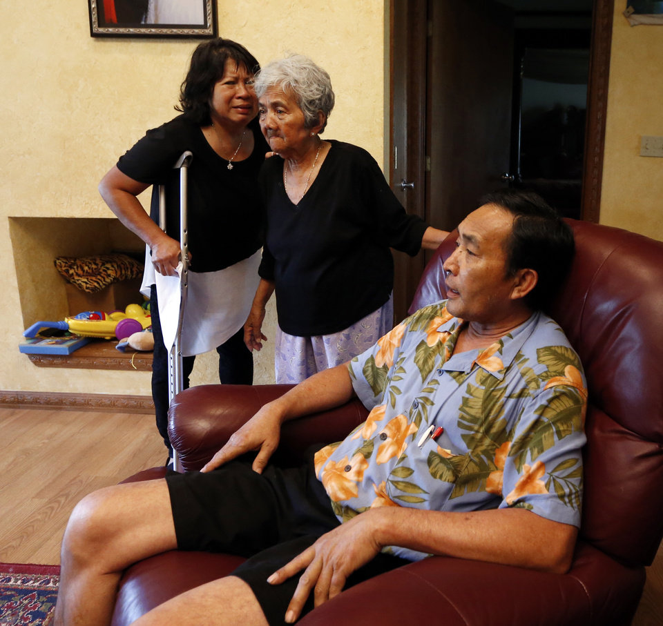 Photo -  Rany Kchao, owner of Whispering Pines, his wife Thavory Kchao and her mother Saruon Panri talk about the FBI investigation into his bed and breakfast and allegations of human trafficking on Wednesday, June 15, 2016 in Norman, Okla. Photo by Steve Sisney, The Oklahoman