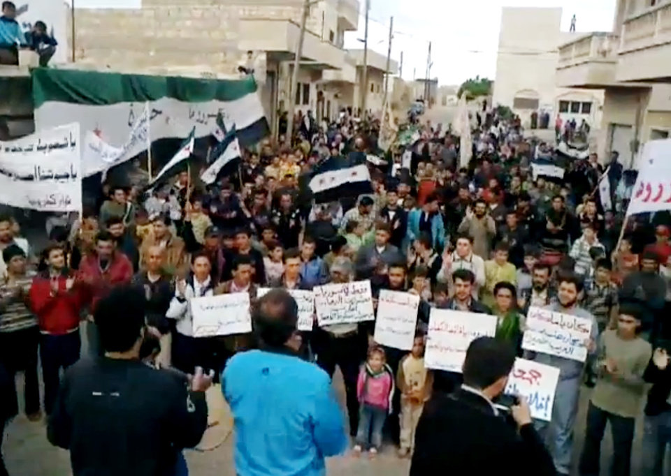 Photo -   This image made from amateur video released by the Shaam News Network and accessed Friday, May 4, 2012, purports to show Syrians chanting slogans during a demonstration in Idlib, north Syria. (AP Photo/Shaam News Network via AP video) TV OUT, THE ASSOCIATED PRESS CANNOT INDEPENDENTLY VERIFY THE CONTENT, DATE, LOCATION OR AUTHENTICITY OF THIS MATERIAL